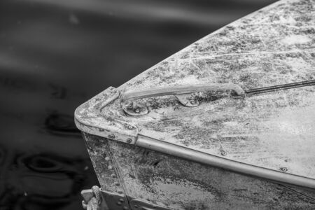 Detail of the front handle of an abandon boat in a lake in Ontario