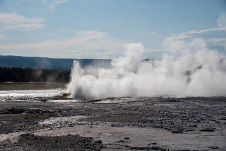 Morning geyser during an eruption in the upper geyser basin in Yellowstone