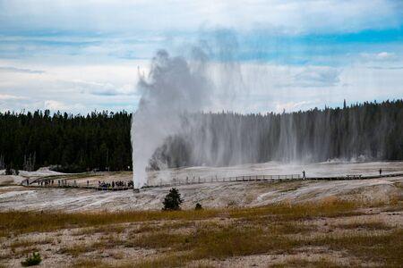 Beehive geyser during an eruption in the upper geyser basin Yellowstone