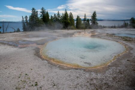 Funnel spring in Yellowstone of vivid colors caused by thermophilic bacteria
