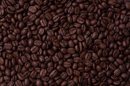 Macro photograph of coffee beans on a flat surface