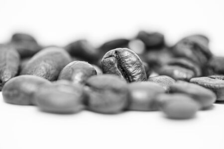 Macro photograph of coffee beans isolated over a white background