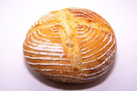 Home baked sourdough loaf on a whithe background Stock Photo