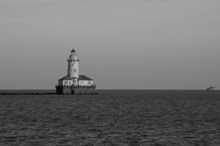 Views of a lighthouse at sunset in the Michigan lake