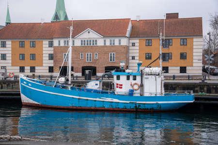 Fishing boat in Helsingør (DK) on a cloudy day 免版税图像