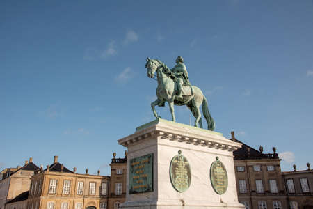 Equestrian statue of King Fredrick V in the middle of Amalienborg square in Copenhagen