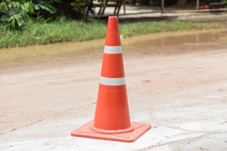 redirect: orange cones on road construction