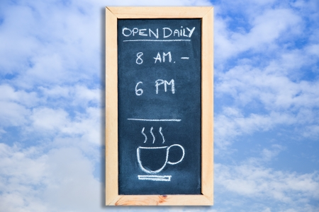 open daily on chalkboard with the sky photo