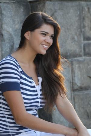 Beautiful, young hispanic woman smiling photo