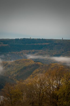 View in a valley with fog in autumn