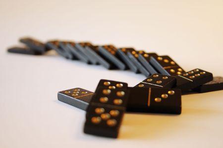 Row of fallen dominoes Stock Photo