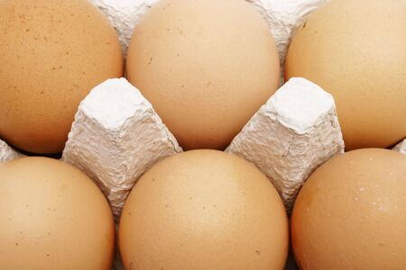 Six brown eggs in a box Stock Photo