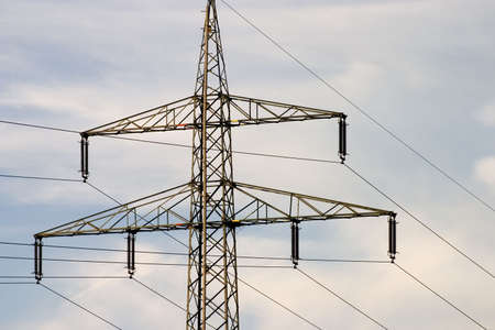 Electrical pylons against blue sky