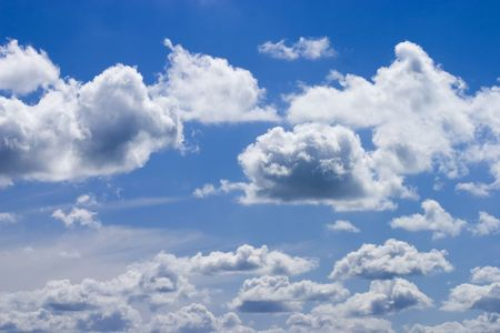 White fluffy clouds and blue sky