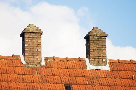 Two chimneys on a roof Stock Photo
