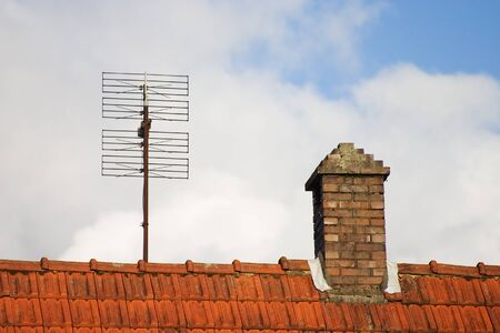 Antenna and chimney on a roof