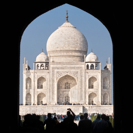 mausoleum: Tourists going through the main gate into the Taj Mahal complex in Agra, India