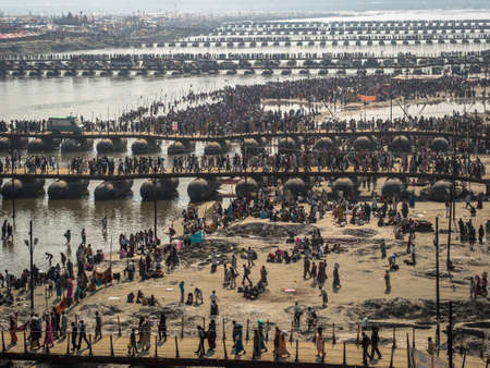 Thousands of Hindu devotees crossing the pontoon bridges over the Ganges River at the massive Kumbh Mela festival in Allahabad, India