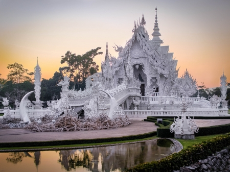 Wat Rong Khun, popularly known as the White Temple, at sunset in Chiang Rai, Thailand