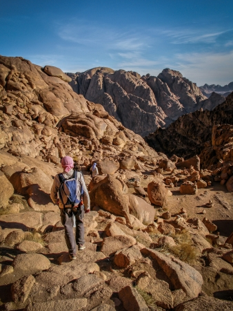 sinai: Hikers walking down sacred Mount Sinai in Egypt Stock Photo