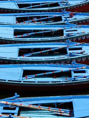 rowboats: Row Boats on the Ganges River in Varanasi, India Stock Photo