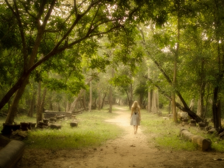Young Woman Walking Barefoot on Mysterious Path in Enchanted Forest Stock Photo