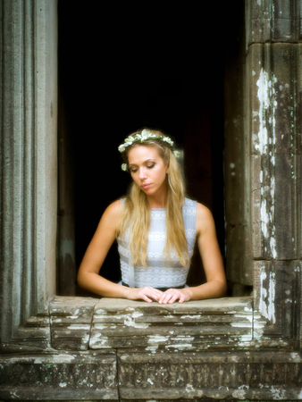 Beautiful, Lonely Fairytale Princess Waiting at Tower Window photo