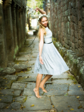Beautiful, Happy Caucasian Woman Dancing Barefoot in Magical Fairytale Setting photo