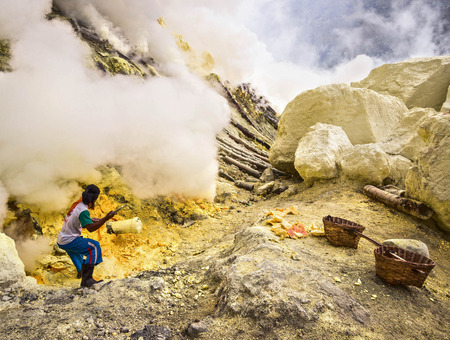 sulphuric acid: Sulfur Miner Extracting Sulfur from Inside the Crater of Kawah Ijen Volcano