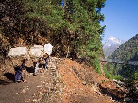 Unrecognizable Sherpa Porters at Work, Everest Region, Nepal  photo