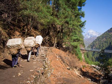 sherpa: Unrecognizable Sherpa Porters at Work, Everest Region, Nepal
