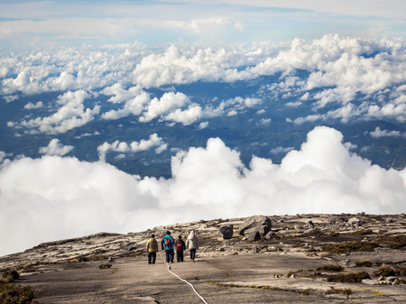 kinabalu: Unrecognizable Hikers Walking Above the Clouds at Mount Kinabalu, Malaysia