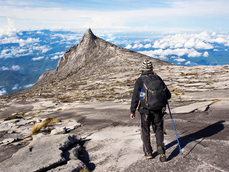 Hiker Walking at the Top of Mount Kinabalu in Sabah, Malaysia Stock Photo