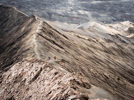 Hikers Walking Around the Rim of Gunung Bromo Volcano, East Java, Indonesia photo
