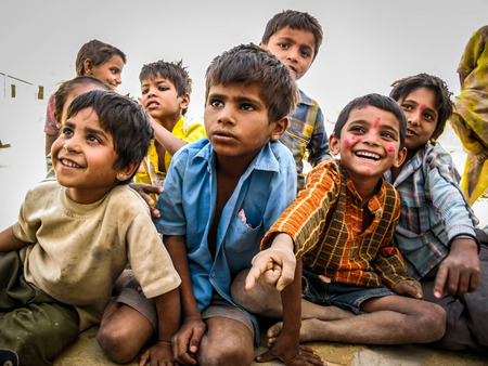 Happy Indian Children Sitting Out, Smiling, at Desert Village in Jaisalmer, Rajasthan, India