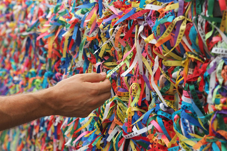 Hand Touching Colorful Senhor do Bonfim Ribbons in Salvador, Bahia, Brazil