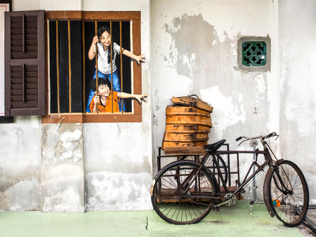 bicycle girl: Street art mural in Georgetown, Penang, Malaysia