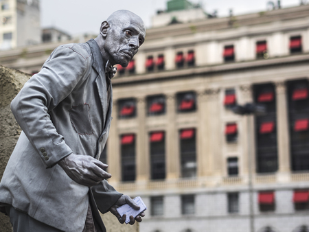 shiny suit: Street artist performing the living statue in Sao Paulo, Brazil Editorial