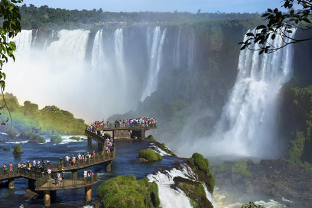 Tourists at Iguazu Falls, near the border of Argentina and Brazil. Stock Photo