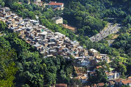 shanty: Traffic on busy highway next to slum shanty town in Rio de Janeiro, Brazil.