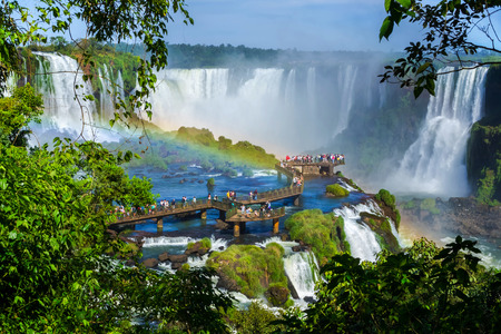 natural landmark: Tourists at Iguazu Falls, on the border of Argentina, Brazil, and Paraguay. Stock Photo