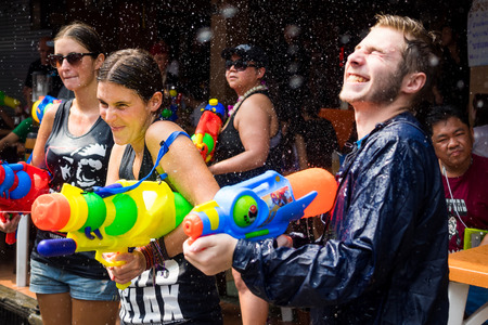 Caucasian tourists at Songkran festival in Bangkok, Thailand 에디토리얼