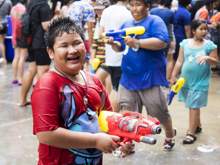Asian boy holding water gun at Songkran festival in Bangkok, Thailand Publikacyjne