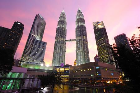 light show: Petronas Twin Towers at Twilight in Kuala Lumpur, Malaysia