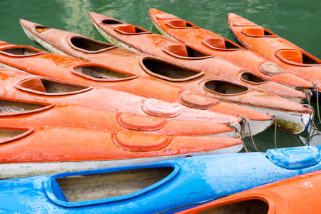 halong: Colorful kayaks in the waters of Halong Bay, North Vietnam