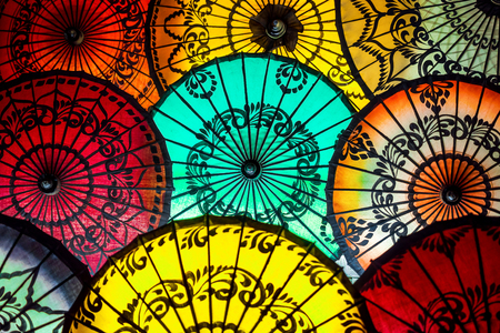 thai decor: Colorful Parasols at Traditional Street Market in Bagan, Myanmar Burma Stock Photo