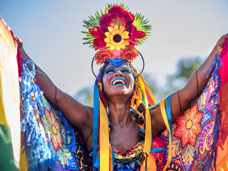Beautiful Brazilian Woman of African Descent Wearing Colourful Costume and Smiling During 2016 Carnival Street Parade in Rio de Janeiro, Brazil