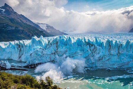 Ice collapsing into the water at Perito Moreno Glacier in Los Glaciares National Park near El Calafate, Argentine Patagonia, South America.