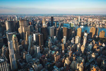 Manhattan skyline including modern landmark buildings by day in New York, United States of America (USA).