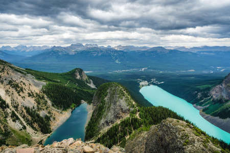 Moody panoramic view showing Lake Louise and Lake Agnes in Banff National Park, Alberta, Canada. Standard-Bild